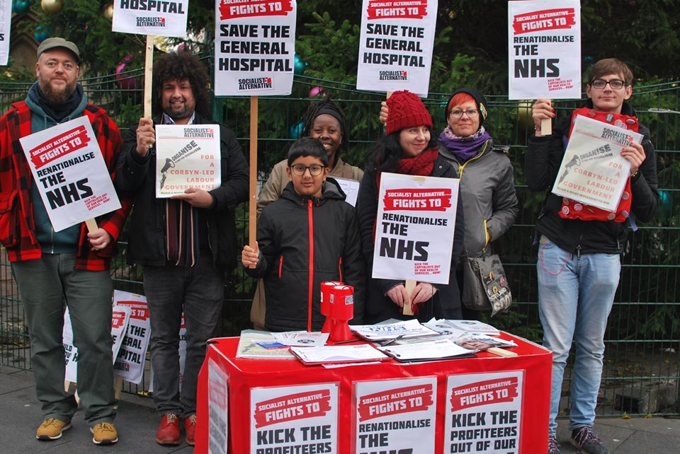 People with signs saying 'save the general hospital' and 're-nationalise the NHS'