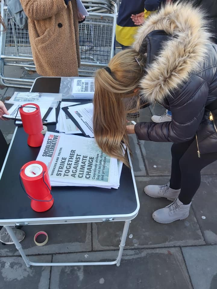 Woman signing petition