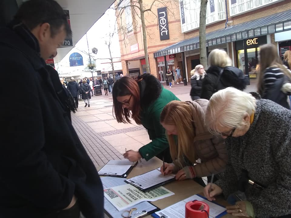 People signing petitions